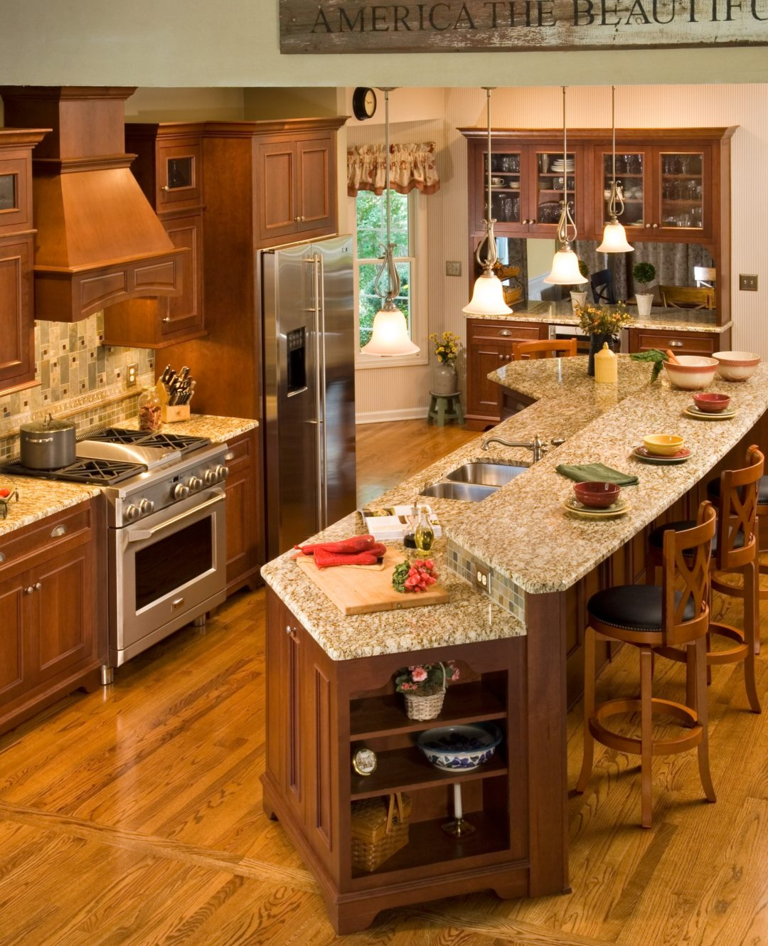 brown kitchen with large island
